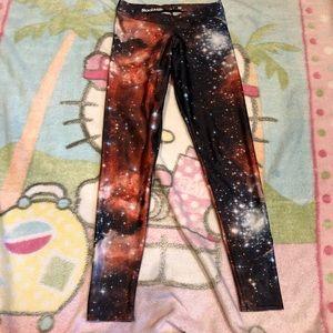 Blackmilk Orange galaxy leggings size m